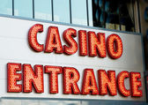 Casino entrance with big neon red letters — Stock fotografie