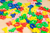 Children letters and digits on the table — Foto Stock