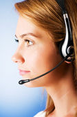 Young call center operator with the headset — Stock Photo