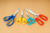 Colorful scissors on the color paper background — Stock Photo