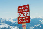 Avalanche sign and mountains at the background — Stock Photo