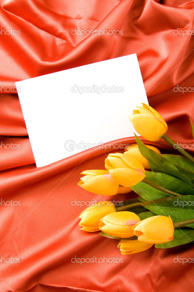 Envelope and flowers on the satin background — Stock Photo #4541951