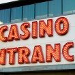 Casino entrance with big neon red letters — Stock Photo #4553865