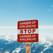 Stock Photo: Avalanche sign and mountains at background