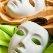 Theatre concept with the white plastic masks - Stock Photo