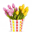 Pot of colorful tulips isolated on white — Stock Photo #4558812