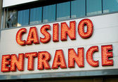 Casino entrance with big neon red letters — Stok fotoğraf