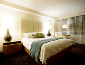 Double bed in the modern interior room — Stock Photo