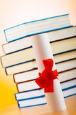 Diploma and stack of books against the background — Stock Photo