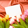 Envelope and flowers on the satin background — Stock Photo #4561706