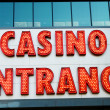 Casino entrance with big neon red letters — Stock Photo #4562762
