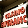 Casino entrance with big neon red letters — Stock Photo #4578063