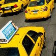 Famous New York yellow taxi cabs in motion — Stock Photo #4578133