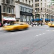 Famous New York yellow taxi cabs in motion — Stock Photo #4578429