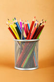 Many colorful pencils on the color background — Stock Photo