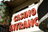 Casino entrance with big neon red letters — Foto Stock
