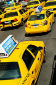 Famous New York yellow taxi cabs in motion — Stock Photo