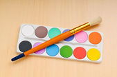 Art concept with painters palette and paint brush — Stock Photo