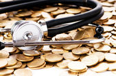 Concept of expensive healthcare with coins and stethoscope — Photo