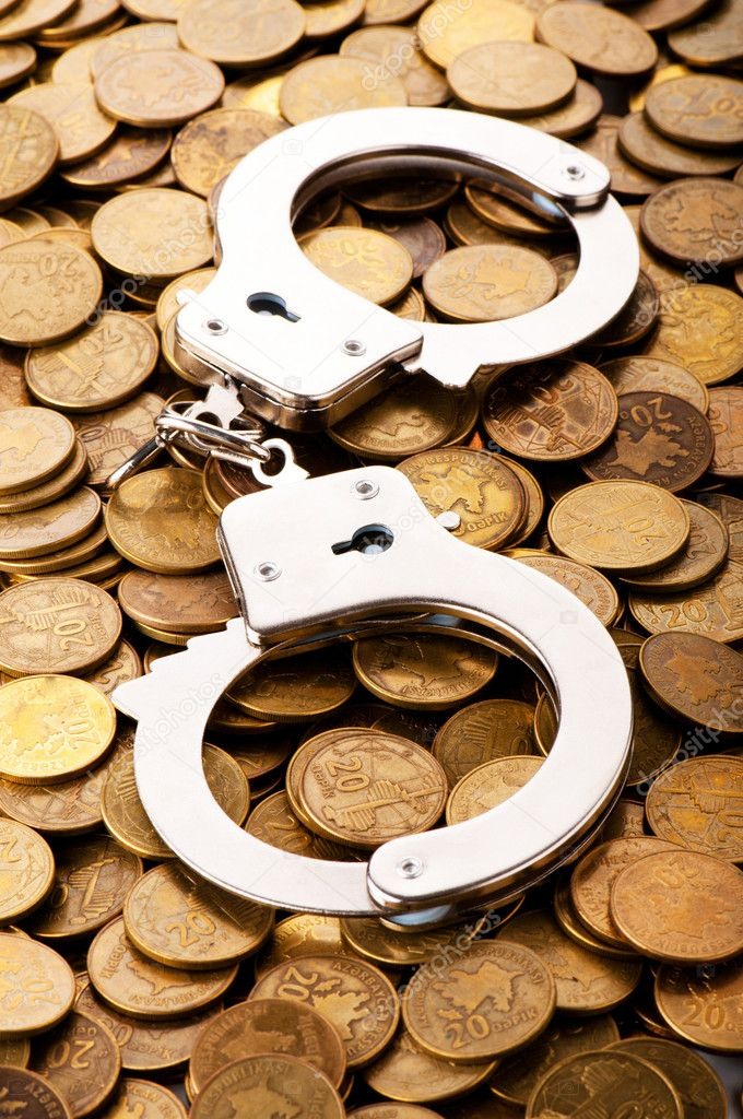 Hand cuffs and coins as security concept — Stock Photo #4578122