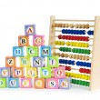 Royalty-Free Stock Photo: Alphabet blocks and abacus isolated on white