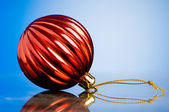 Christmas decoration on the reflective background - holiday conc — Stock Photo