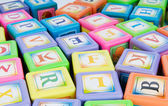 Learning and education concept - pile of alphabet blocks — Stock Photo