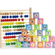 Stock Photo: Alphabet blocks and abacus isolated on white