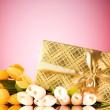 Celebration concept - gift box and tulip flowers — Stock Photo #4591677