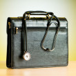 Doctor's case with stethoscope against colorful background — Foto Stock