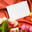 Envelope and flowers on the satin background — Stock Photo #4597325