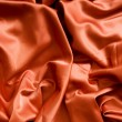 Bright satin fabric folded to be used as background — Stock Photo