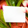Stock Photo: Envelope and flowers on the satin background