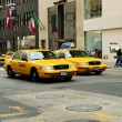 Famous New York yellow taxi cabs in motion - Stock Photo