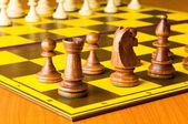 Zestaw szachy figury na planszy gry — Zdjęcie stockowe