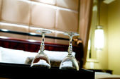 Two glasses on the double bed as romantic concept — Стоковое фото