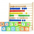 Alphabet blocks and abacus isolated on white — Stock Photo #4610088