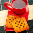 Cup of tea and fresh cookies on table - Stockfoto