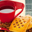 Cup of coffee with many beans around — Stock Photo