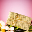 Celebration concept - gift box and tulip flowers — Stock Photo #4613993