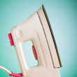 Modern electric iron against the colorful background — Foto Stock