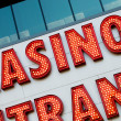 Casino entrance with big neon red letters — Stock Photo #4618901