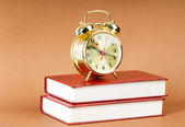 Back to school concept with books and clock — Stock Photo