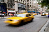Famous New York yellow taxi cabs - intentional blur — Stock Photo