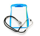 Stethoscope on the binder isolated on white — Stock Photo