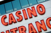 Casino entrance with big neon red letters — Foto de Stock