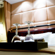 Two glasses on the double bed as romantic concept — Foto Stock