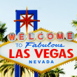Famous Las Vegas sign on bright sunny day - Stock Photo