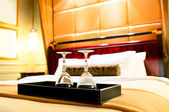 Two glasses on the double bed as romantic concept — Stock Photo