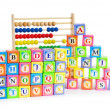 Alphabet blocks and abacus isolated on white — Stock Photo #4640387